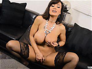 Lisa Ann shoves her dildo deep in her humid vulva