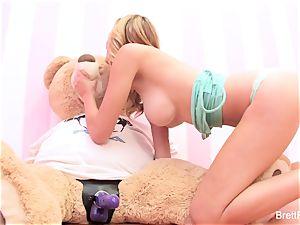 Brett Rossi plays with a stuffed bear's strap-on fuck stick