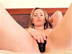 magnificent blond Brett fingers her beaver for the camera