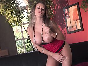 Jenna Presley takes it off leisurely to demonstrate off her big bra-stuffers and smoking assets